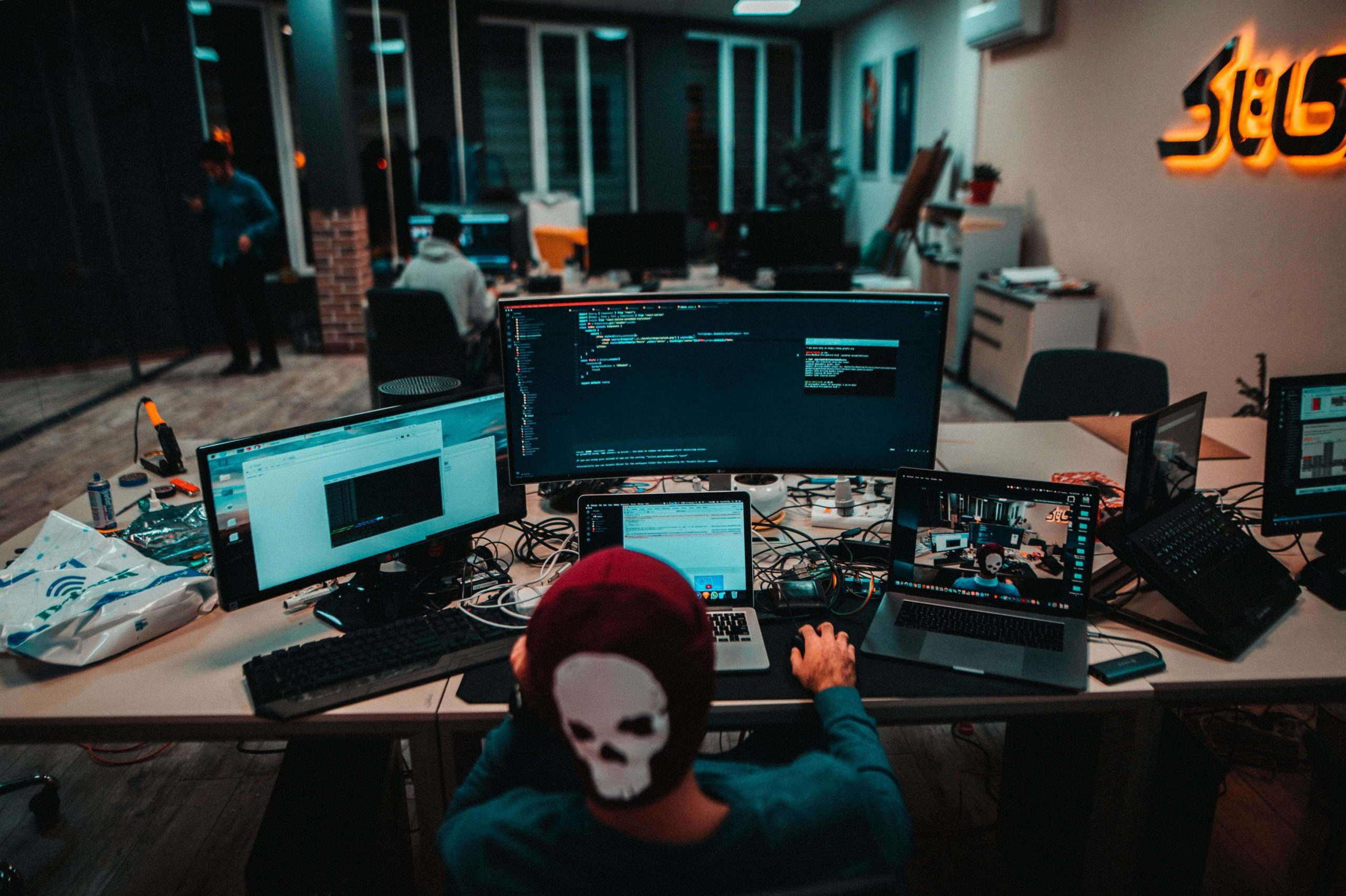 web-developer-working-multiple-screens