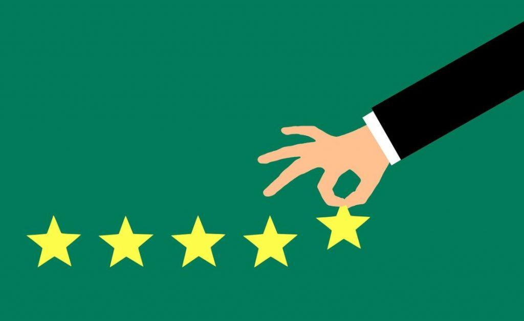 hand choosing star rating