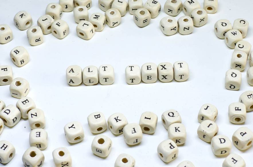 white dice letters scattered around alt text letters middle